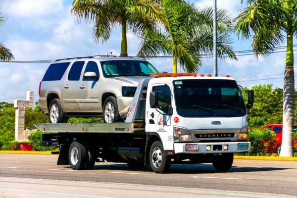 SUV on a tow truck after car repossession.