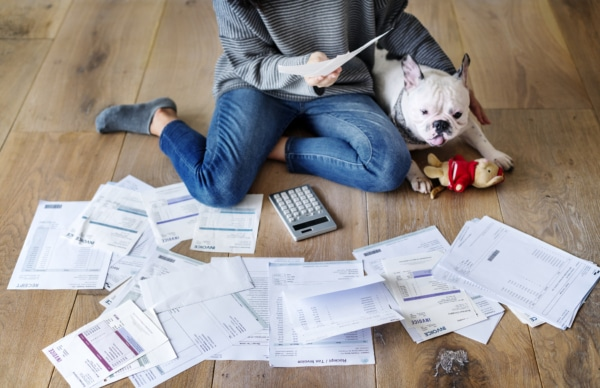 Woman sorting through bills trying to pay off credit cards.