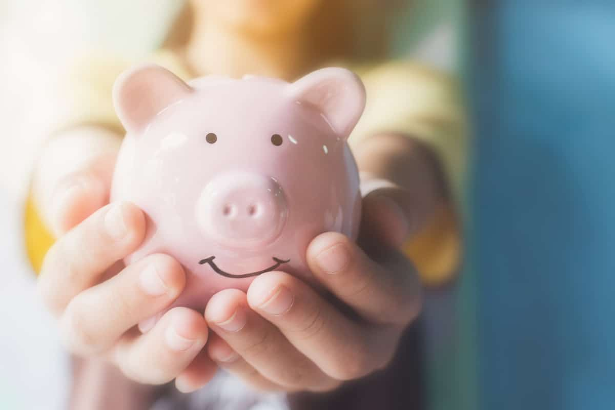 Woman holding a piggy bank symbolizing the positive aspect of chapter 7 bankruptcy.