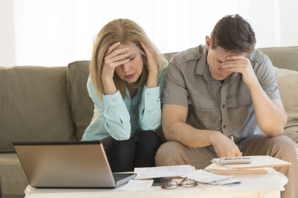 Concerned couple considering personal bankruptcy.