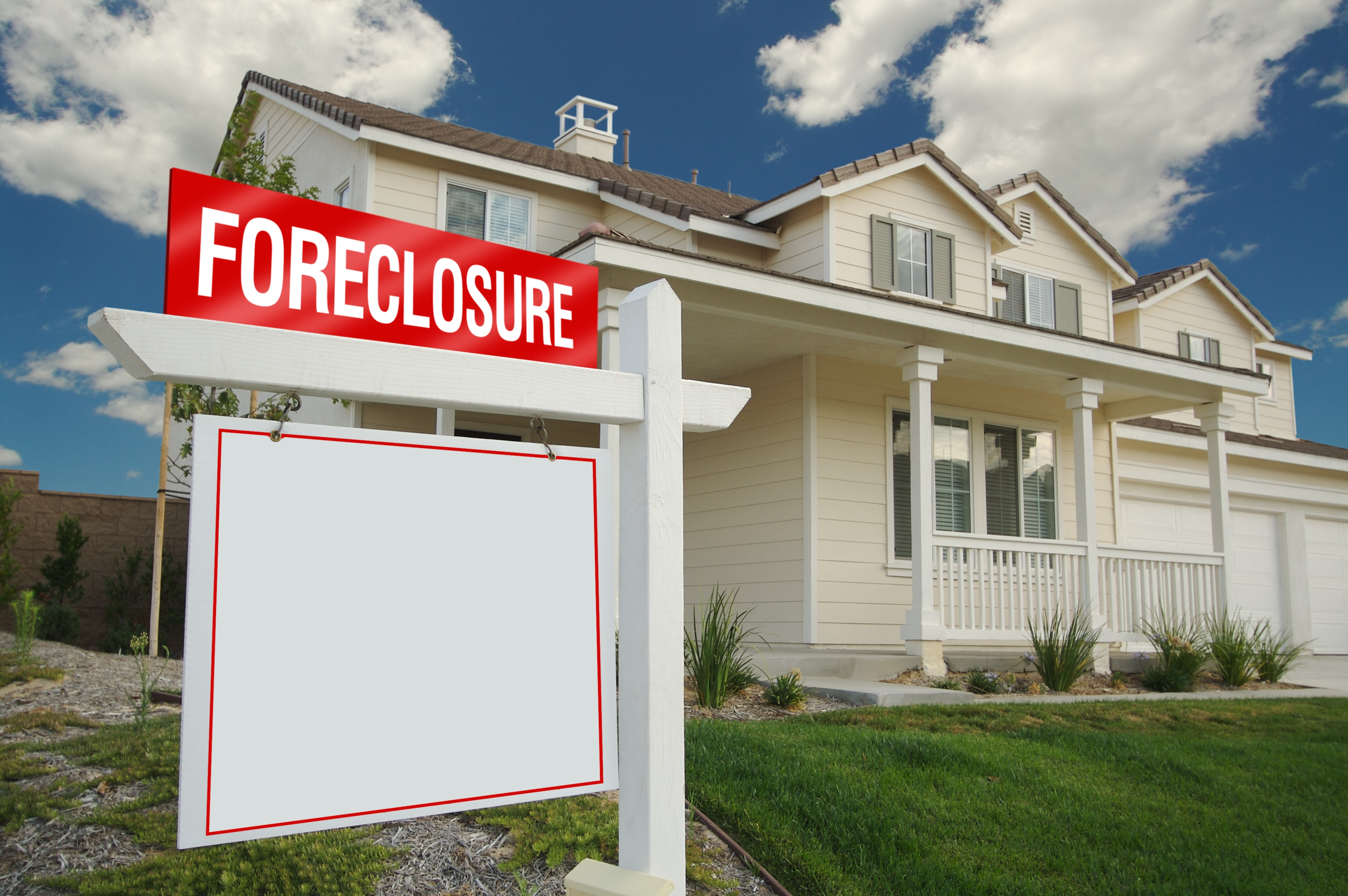 Blank Foreclosure Sign in Front of House